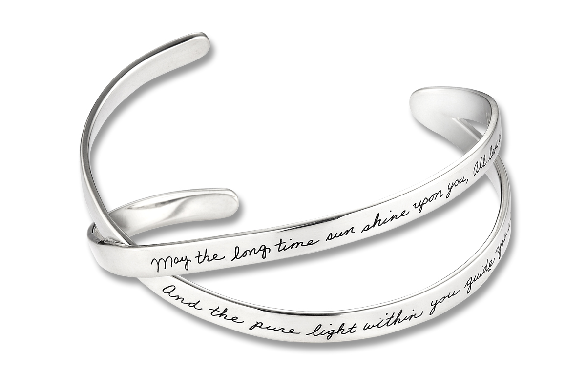 Bracelet With Two Silver Bands Crossing At Mid Point Merging One End And Open